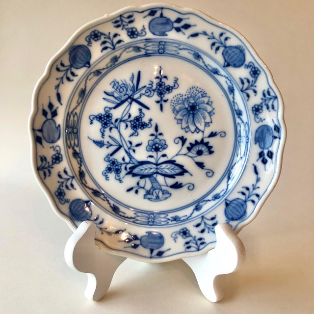 This antique Meissen dinner plate features hand painted blue onion design on a seven inch plate. Manufacturer's mark of...