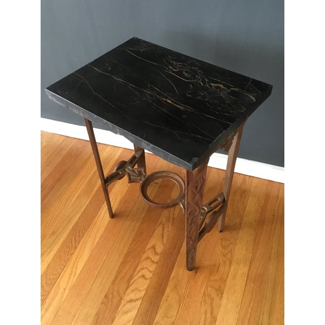 This is an amazing little side table found at a flea market in up state New York. The top is black marble with some minor...