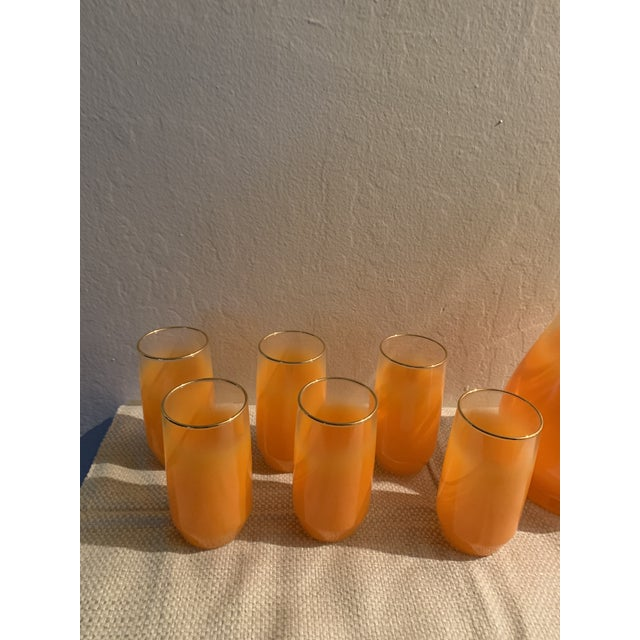This seven piece set of West Virginia glass is in pristine condition. You can see the brand label in in place. West...