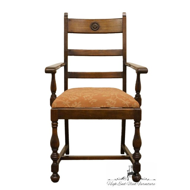 This is a vintage walnut dining chair. The piece is from the 1940s.