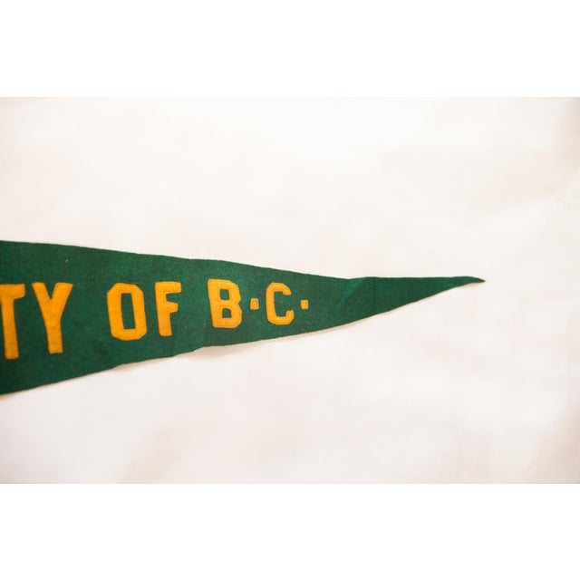 :: University of British Columbia in large capitalized block lettering, older pennant and really lovely color combo....