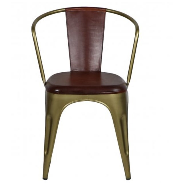 A classic metal chair is enhanced with hand-rubbed, auburn-colored leather upholstery, making the Cigar Chair a popular...