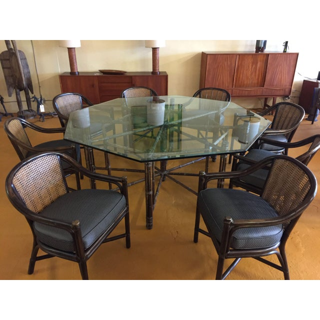 McGuire Furniture iconic bamboo and rawhide dining table base with the original very thick, beveled glass top. Table...