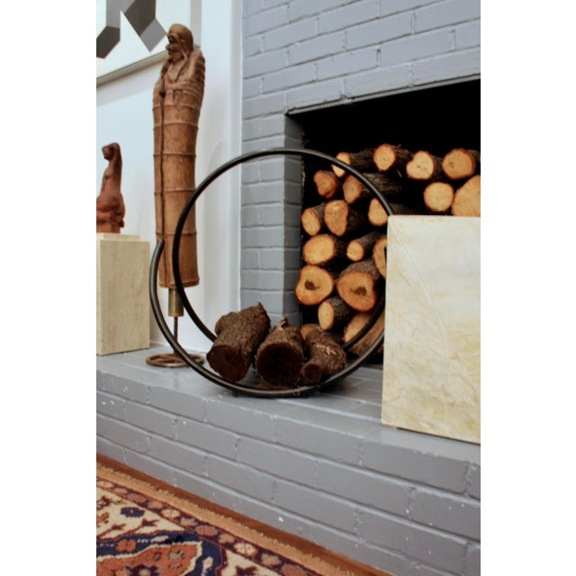 """Whimsical """"spring"""" style heavyweight iron and woven rope firelog holder. Great modernist / minimalist aesthetic."""