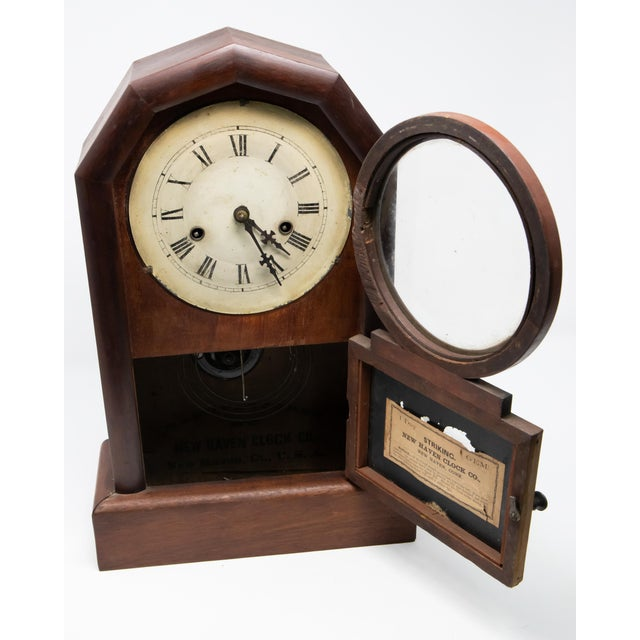 Mantle clock by New Haven Clock Co. Simple lines make this clock so easy to see. Starting on a rectangular base it rises...