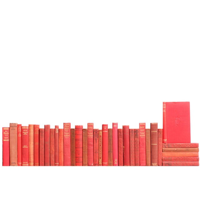 Thirty-five vintage volumes in varied shades of red. Various authors and publishers: 1927 - 1955. Includes classic works...