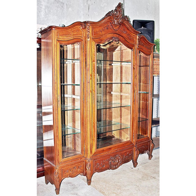 Make your room around this stunning 19th century solid hand-carved French walnut 3-door Louis XV style armoire, repurposed...