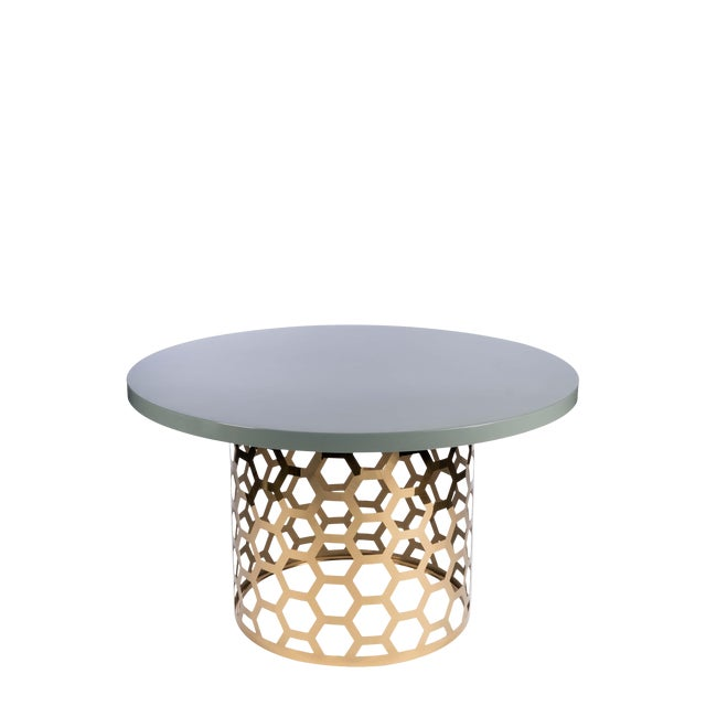 New round dining table sits 6-7 people. A modern round dining table with a stainless steel showcase a cut out design on...
