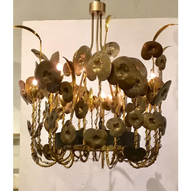 Stylish modern brutalist Style Lily Pad chandelier by: Studio A Home, brass arms wrapped in black metal, hammered metal...