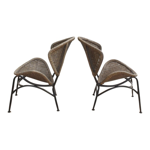 pair of mid century modern wicker chairs in the manner of