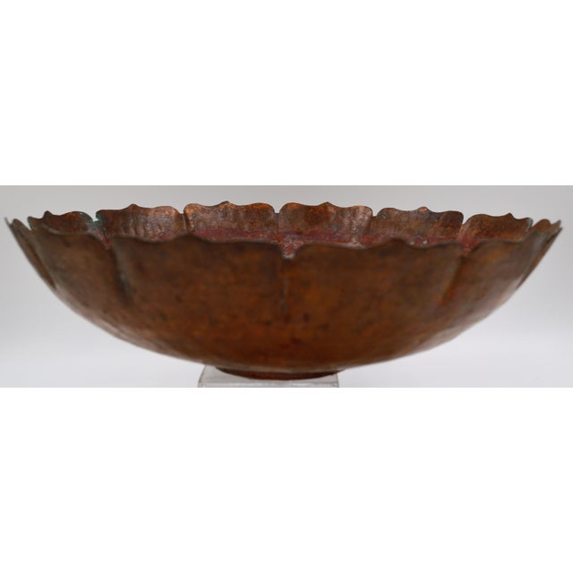 Large hand hammered beaten copper bowl in lotus flower shape with a flat base. Bowl left with original patina and water...