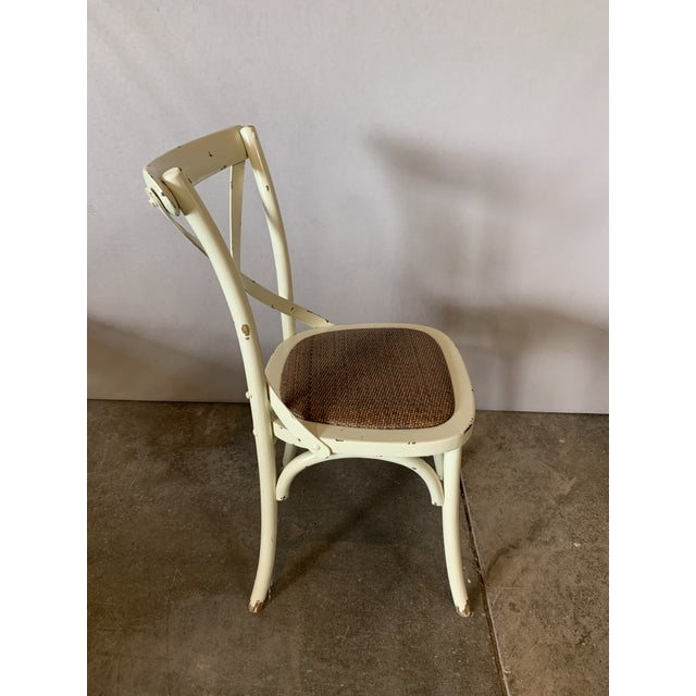 Wood chair with metal criss cross back and braided seat