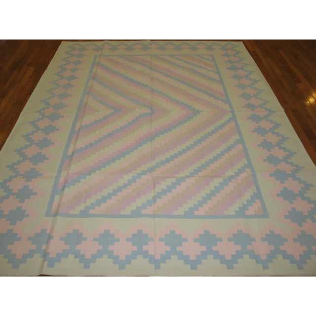 This is a fine handmade Dhurry kilim rug from India. The rug is made with all cotton material. It is reversible and can be...