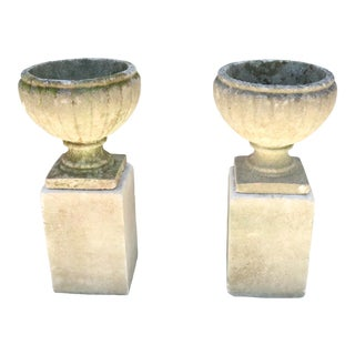 Early 20th Century English Cast Stone Garden Urns on Tall Bases- A Pair For Sale