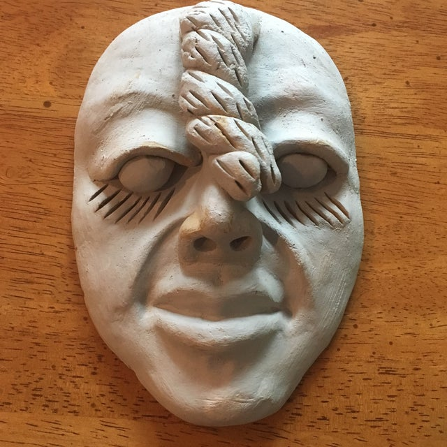 This is a great conversation piece. It is handmade, but looks like a studio pottery piece as it looks very lifelike. Would...
