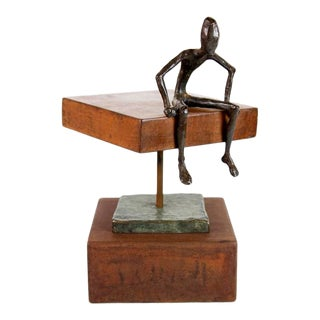 Man Reclining on a Steel Plate Sculpture For Sale