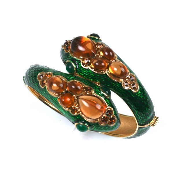 Wonderful Trifari Jeweled Snake Bangle in the style of David Webb. Deep green enamel is used to counterpoint the faux...