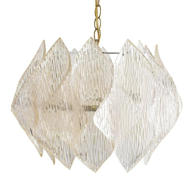 Gorgeous midcentury, folded, acrylic chandelier light. Brass frame and surrounding folded acrylic or Lucite shades which...
