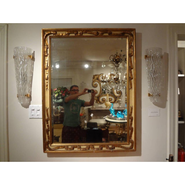 Versatile Italian painted mirror with gilt ribbon design, circa. 1920. Can be hung vertically or horizontally.