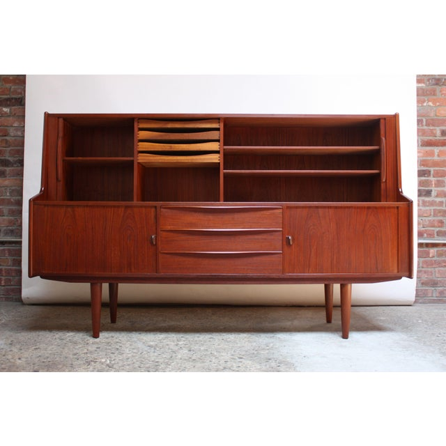 IB Kofod-Larsen highboard designed for Faarup. Early example (1950s) in dark teak with multiple storage compartments....