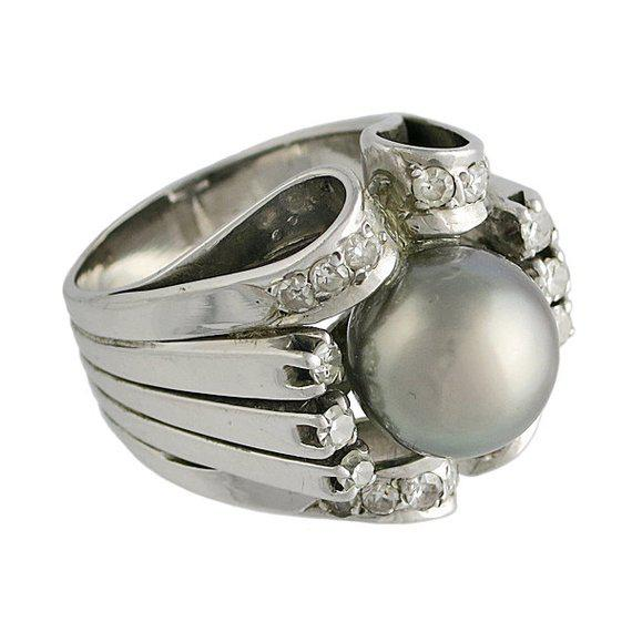 A vintage 18K White Gold Silver South Sea Pearl Diamond Ring, c. 1970s. It tests 18K. The pearl is 11 mm and the diamond...