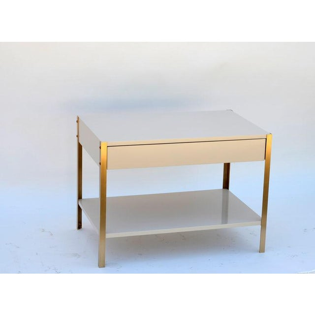 Chic high gloss ivory white lacquer and brushed (not polished) brass night stand. Soft close drawer slides. Bottom shelf...