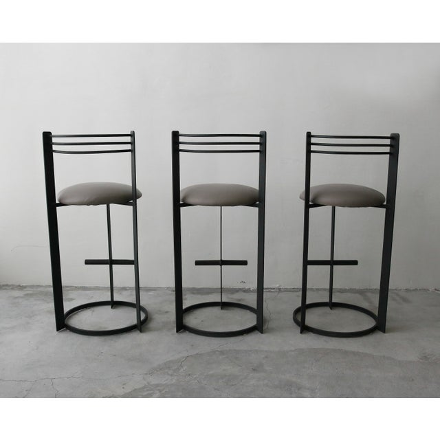 Great set of 3 post modern bar stools. Constructed of solid plate steel frames these stools are heavy and very well...