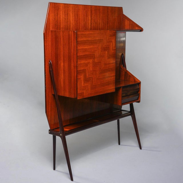 Free standing Italian wall cabinet features a flat back with slender, angled legs and nicely figured wood veneer that...