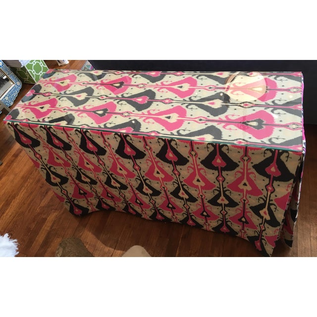 Skirted pink and indigo ikat console table with glass top and storage underneath. Perfect scale for behind a sofa or in a...
