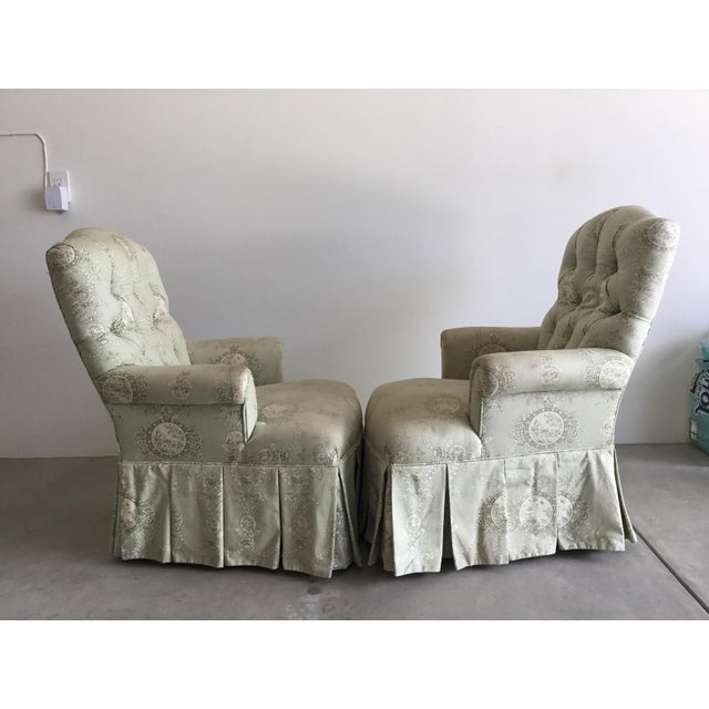 Charming pair of vintage upholstered chairs, with rolled arms. Beautiful tufting on the back. Low seating.