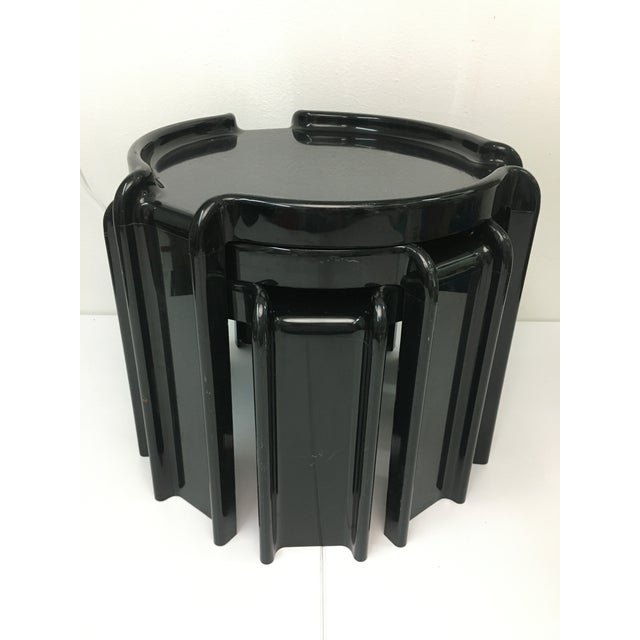 Compact set of three injection-molded plastic tables that stack for multiple storage and display options. Each table is...