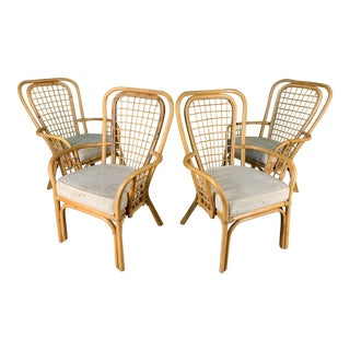 Set of Four Rattan Fan Back Arm Chairs For Sale
