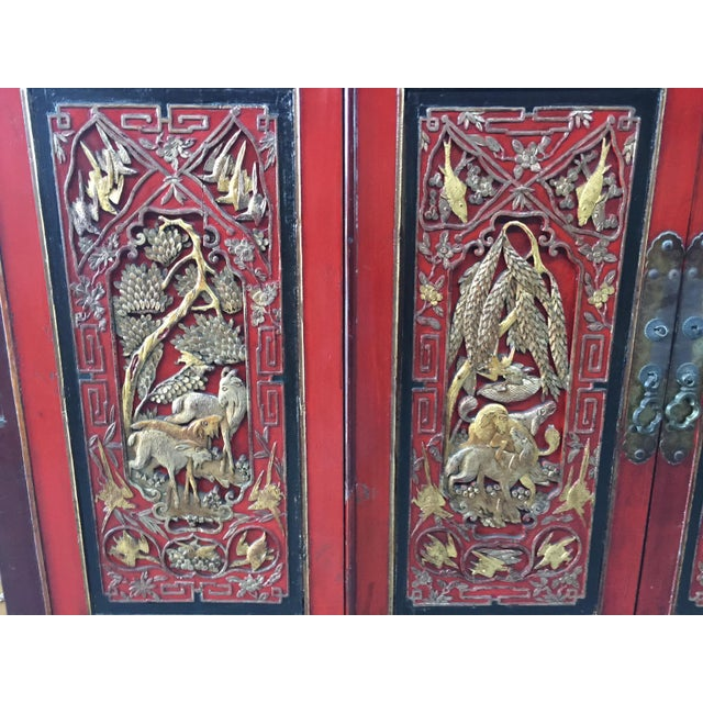 Antique carved lacquer Asian cabinet. Stunning carved panels with birds , animals and trees. I love the carved koi fish at...