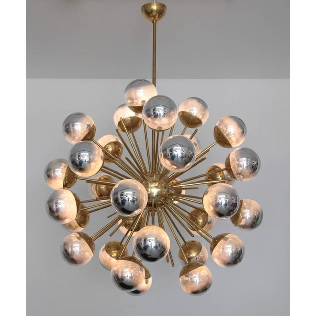 Exceptional huge Murano glass and brass Sputnik chandelier in the manner of Stilnovo. The chandelier has a very impressing...