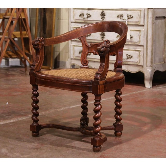 This elegant antique armchair was crafted in France, circa 1880. Built of oakwood, the armchair stands on barley twist...