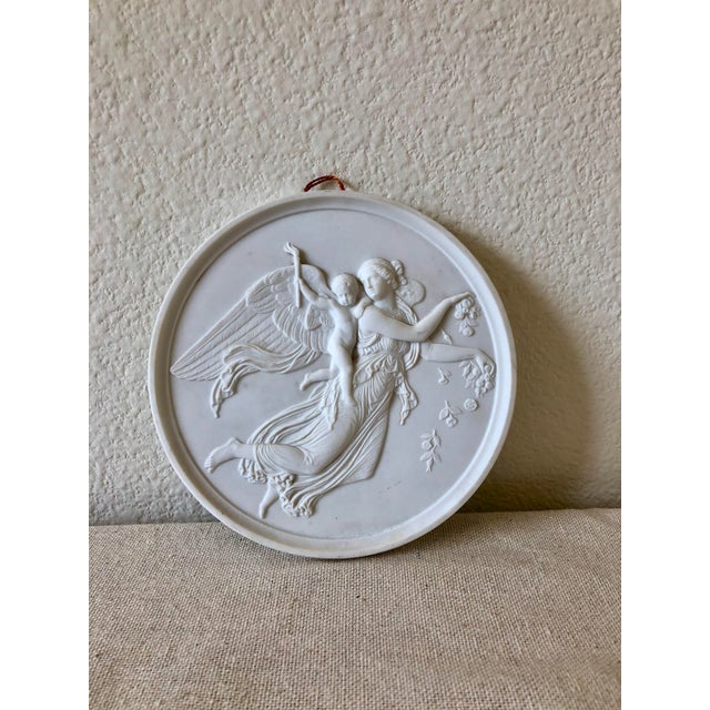 These Danish Bing & Grøndahl plates angelic relief wall plaques hail from the 1960s and perfecting represent the...
