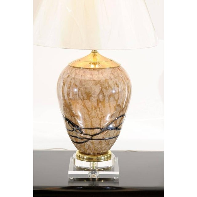 A stunning pair of Eastern European blown glass vessels as custom-made lamps. Fabulous form and scale in tones of Caramel...