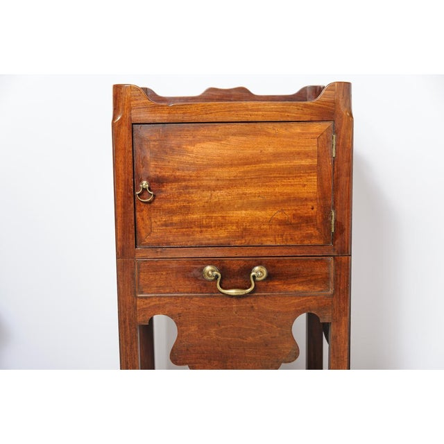 English Georgian mahogany night stand with a cupboard and the pullout with the porcelain pot and wood cover. Has original...