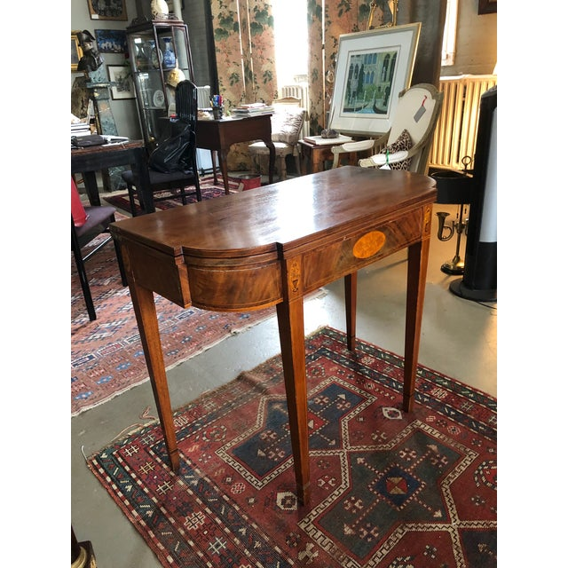 Lovely Period Circa 1770-1795 American Hepplewhite Inlayed Mahogany Game Table. Serves as a side table when folded up. The...