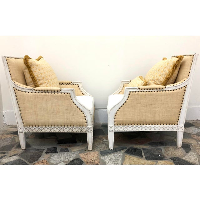 Beautiful pair of Oly Studio Tobias armchairs, originally $3,000 each ($6,000 list ea.) An antique white finish on the...