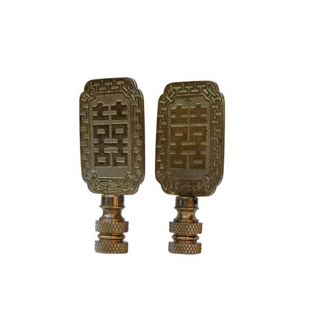 A pair of solid brass finials with the Chinese symbol for 'Double Happiness'. Fits a standard size lamp harp. Measurements...