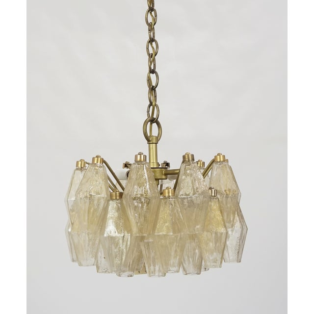 Amazing polyhedral chandelier by Carlo Scarpa for Venini. Multiple polyhedral form, gold flecked pieces, lit from above....