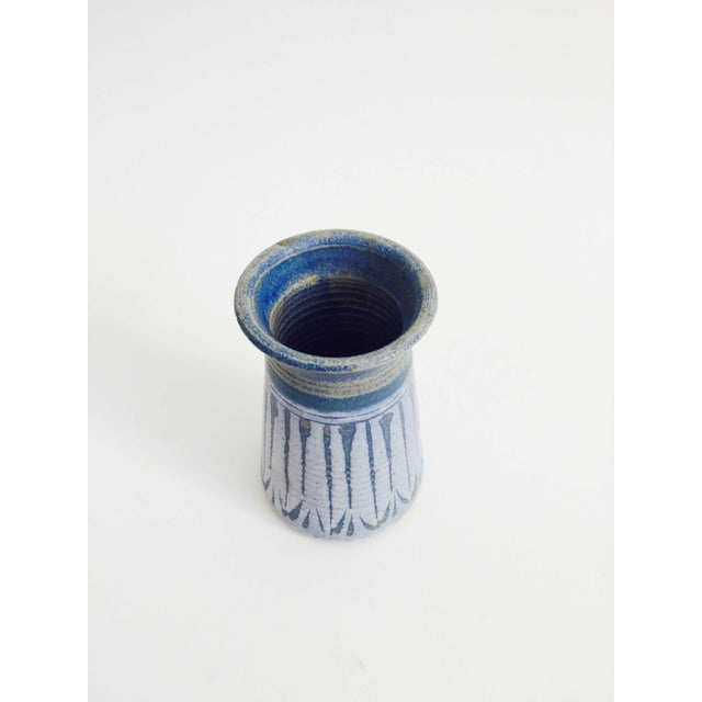 A wonderful mid century studio pottery vase in muted blue hues.