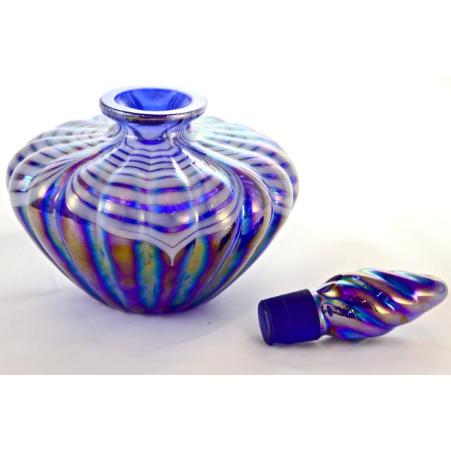 Vibrant vintage ribbed cobalt and pulled feather pattern blown art glass perfume with ground stopper in iridescent hues of...