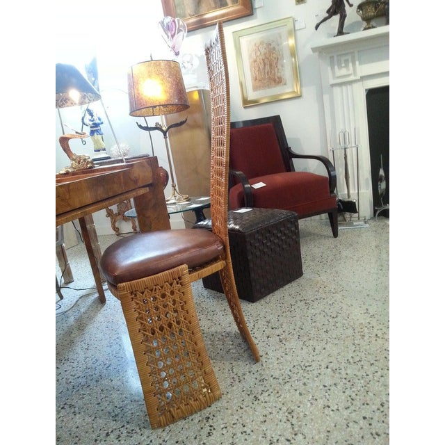 This stylish set of six dining chairs were designed by Danny Ho Fong, and are executed with a steel frame wrapped in...