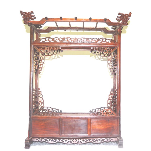 A traditional Scholar's brush stand in a dark rich solid rosewood with elaborate carvings and finished with a smooth...