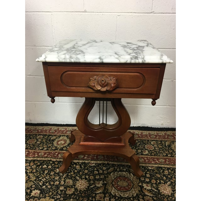 """Mahogany table a with removable Italian marble top. Measures 19.25"""" x 15"""" top & 27.25"""" Height. Excellent condition."""