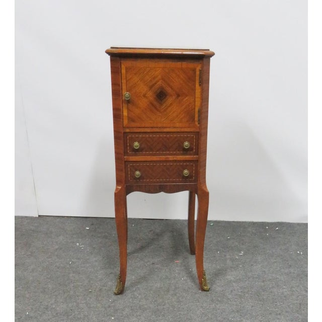 Louis xv Style book matched rosewood veneer nightstand. 1 door 2 drawers, brass mounts on feet