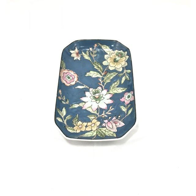 Asian coffee table tray/catchall dish with hand painted floral design on a blue background. Maker's mark on underside.