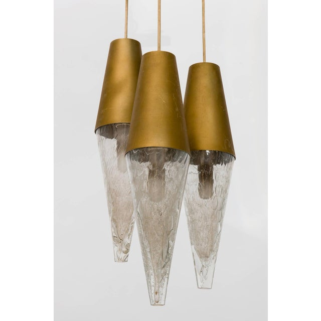 Three pendant staggered glass and metal cone, 1950s fixture.